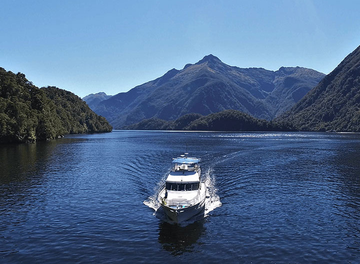 Aerial view of the Southern Secret cruising in Doubtful Sound.
