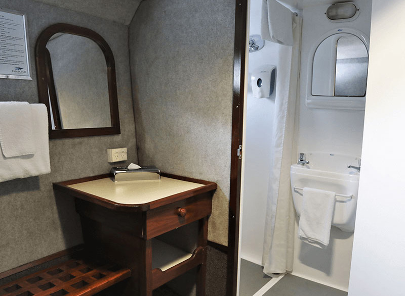 Inside one of the Southern Secret's cabins showing the entrance to the ensuite bathroom.